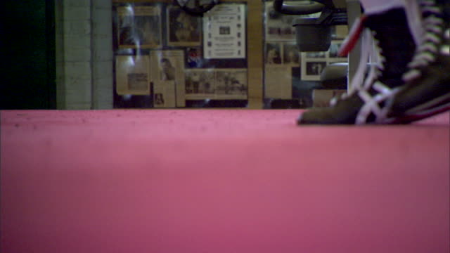 CUs Male boxer in boxing ring wearing boxing shoes walking around ring push stepping doing footwork shadow boxing Sports