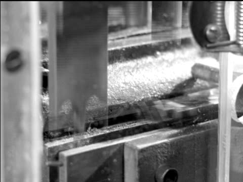 / cus of women's hands working on drug containers / automatic machinery filling and capping vials / pills pouring down chute out of machine / cu of... - 1959 stock-videos und b-roll-filmmaterial