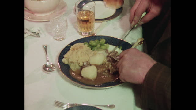 cus people tuck into christmas dinner, uk, 1970s - social grace stock videos & royalty-free footage