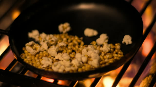 cus popcorn cooked on a campfire grill - fire natural phenomenon stock videos & royalty-free footage