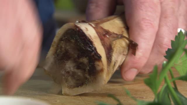 CUs preparing a meaty sauce using bone marrow