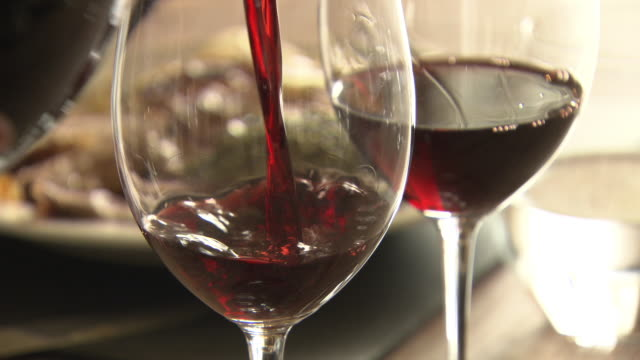 cus red wine being poured into wineglasses - french culture stock videos & royalty-free footage