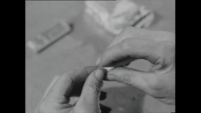 cus rolling and stubbing out cigarette - 1959 stock videos & royalty-free footage