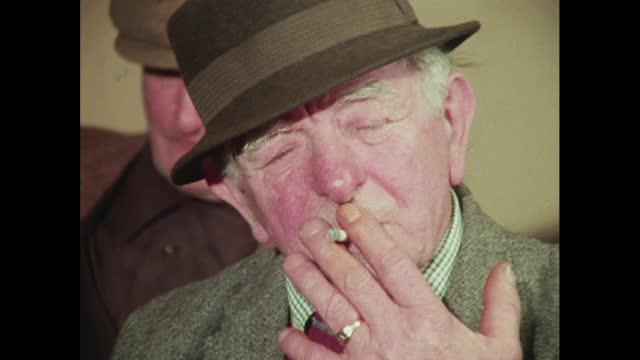 cus senior men in a pub in the 1970s, uk - senior men stock videos & royalty-free footage