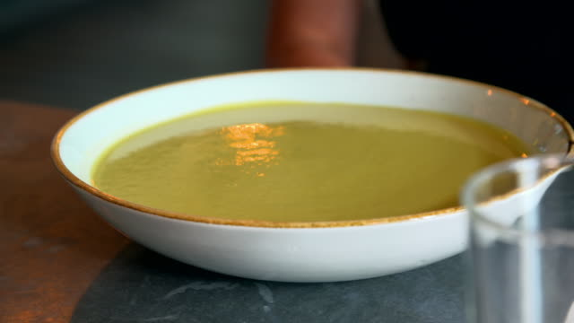cus smooth brownish-green soup in a wide bowl - thick stock videos & royalty-free footage