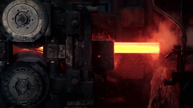 cus steel rod being produced with heavy machinery - thick stock videos & royalty-free footage