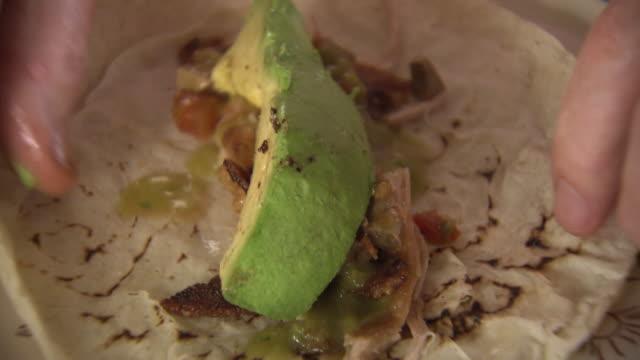 cus tortilla with avocado and pork, mexico - cuban culture stock videos & royalty-free footage