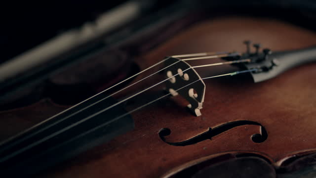 cus violin being played - probe stock-videos und b-roll-filmmaterial