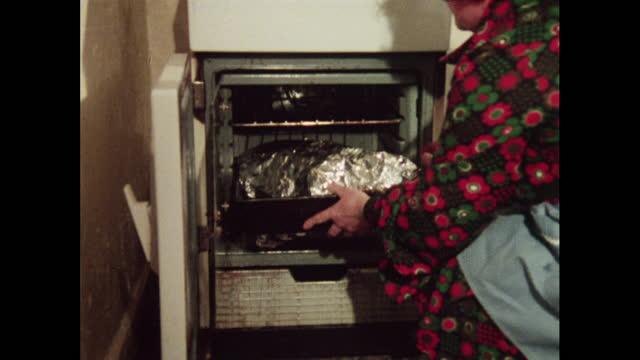 cus woman prepares goose for roasting - gender stereotypes stock videos & royalty-free footage