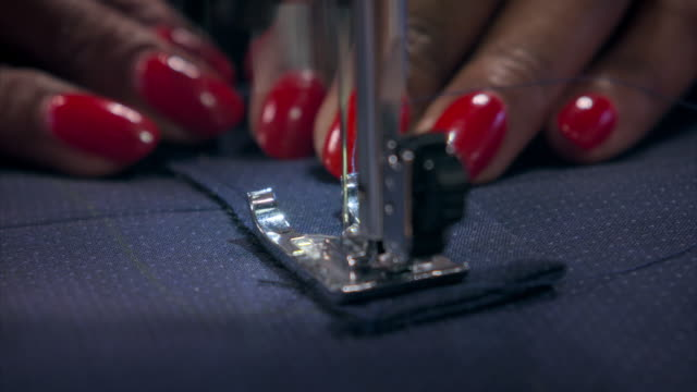 cus woman using a sewing machine - sewing stock videos & royalty-free footage