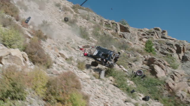 custom black 1970 dodge charger flies off of cliff and crashes - stunt stock-videos und b-roll-filmmaterial