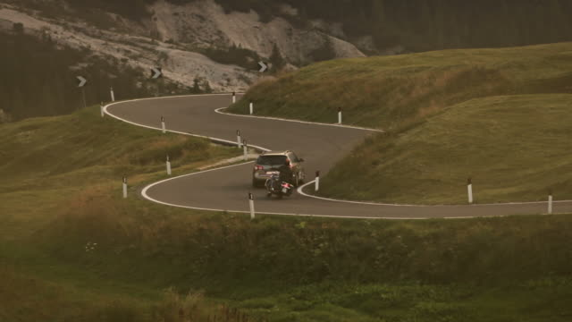 custom motorbike overtaking a car on mountain road - overtaking stock videos and b-roll footage