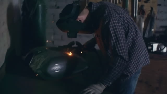 custom motorcycle builder welding - petrol tank stock videos and b-roll footage