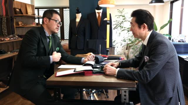 custom suit shop in tokyo - customer focused stock videos & royalty-free footage