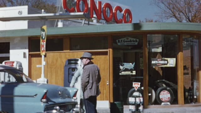 1956 ms td customer and attendant talking at conoco gas station / usa - gas station attendant stock videos and b-roll footage