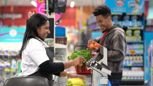 customer and cashier in checkout at supermarket - checkout stock videos & royalty-free footage