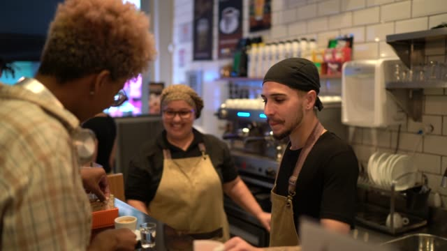 customer being served by the waiter - barista stock videos & royalty-free footage