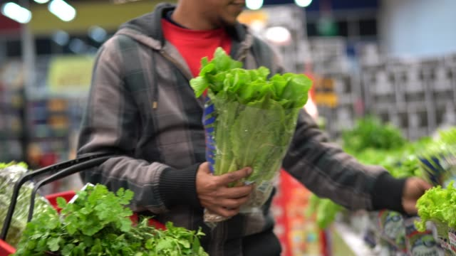customer buying greens on supermarket - touching stock videos & royalty-free footage