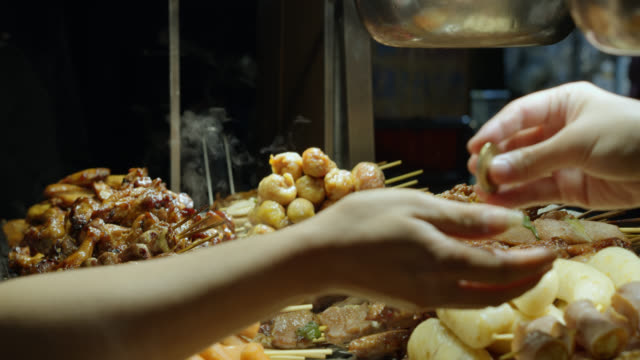 customer buying meat skewers at raohe night market - taipei stock videos & royalty-free footage