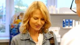 Customer buying prescription medicine at pharmacy
