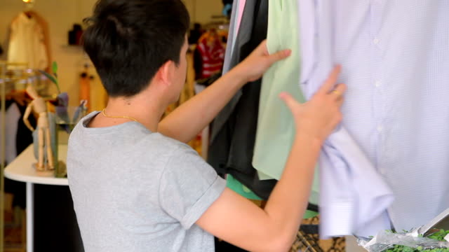 Customer choosing clothes in a boutique
