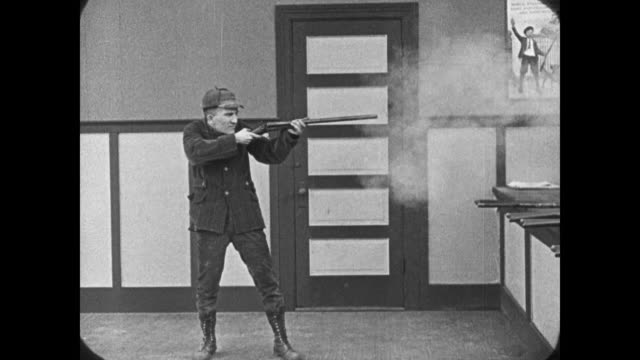 1921 Customer destroys shooting gallery with shotgun, wins prizes