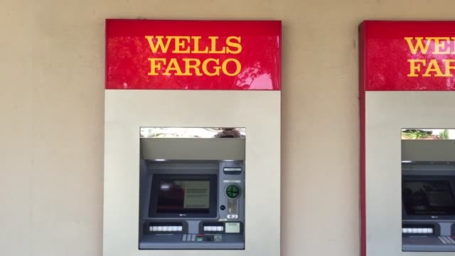 Customer exits Wells Fargo branch in San Bruno Calif Customer exits Wells Fargo branch in San Bruno Calif wide shot of west side of Wells Fargo...