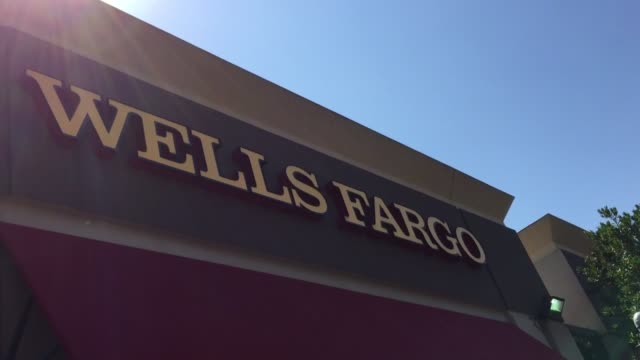 Customer exits Wells Fargo branch in San Bruno Calif Customer exits Wells Fargo branch in San Bruno Calif wide shot of west side of Wells Fargo...