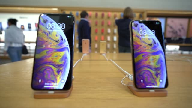 Customer experience the new iPhones at launch at Apple Store Regent Street on September 21 2018 in London England