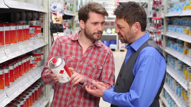 Customer gets some advice from a shop assistant in a hardware store.