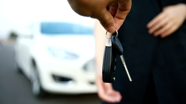 customer getting new car keys - giving stock videos & royalty-free footage