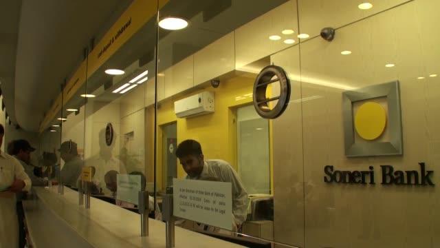 customer goes through security screening before entering a soneri bank ltd bank branch in karachi, pakistan, on wednesday, dec. 11 visitors depart a... - branch stock videos & royalty-free footage