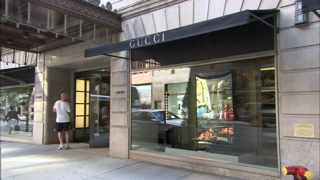 WS, Customer leaving Gucci store, Madison Avenue, New York City, New York, USA