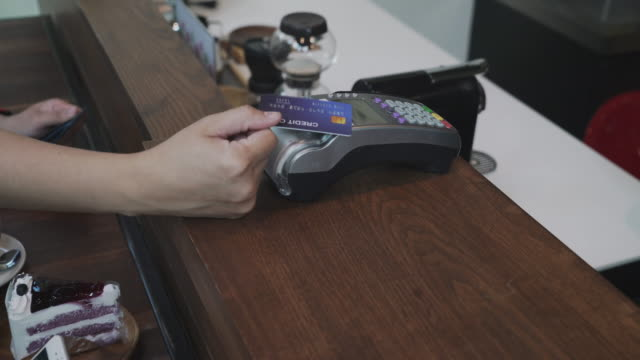 customer make a contactless payment via credit card at cafe coffee shop and restaurant - near field communication stock videos & royalty-free footage