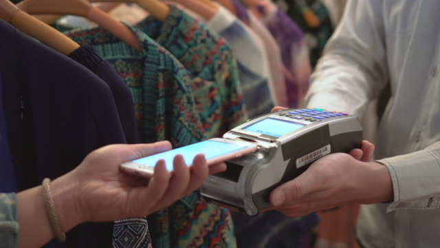 customer making contactless payment with smart phone - paying stock videos & royalty-free footage