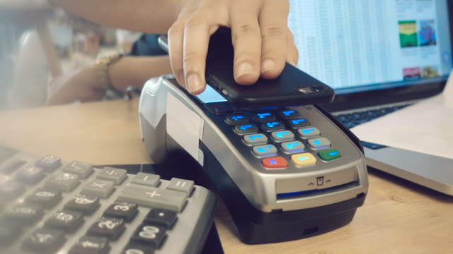 customer making contactless payment with smart phone - online banking video stock e b–roll