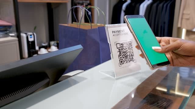 customer making payment using qr-code - clothes shop stock videos & royalty-free footage