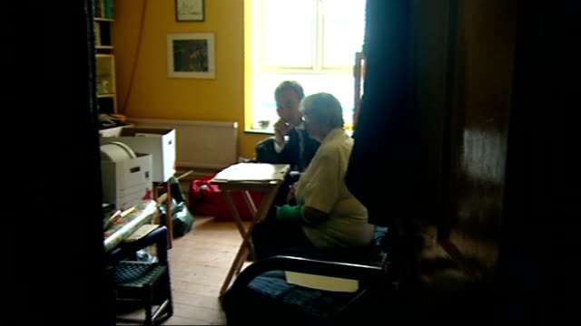 edf customer may phillips looking at fuel bills with reporter and interview sot may phillips switching on light and boiling kettle to make cup of tea - tea kettle stock videos & royalty-free footage