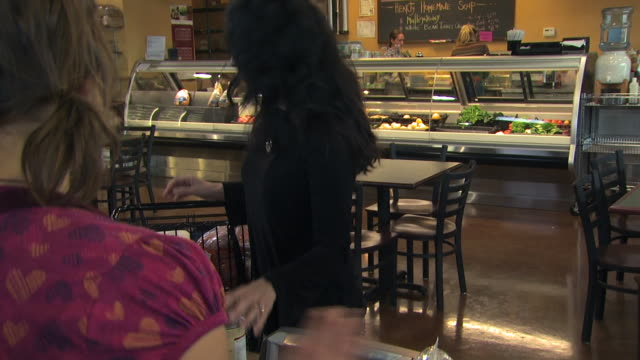 customer offering a reusable bag to a grocery clerk - see other clips from this shoot 1172 stock videos & royalty-free footage