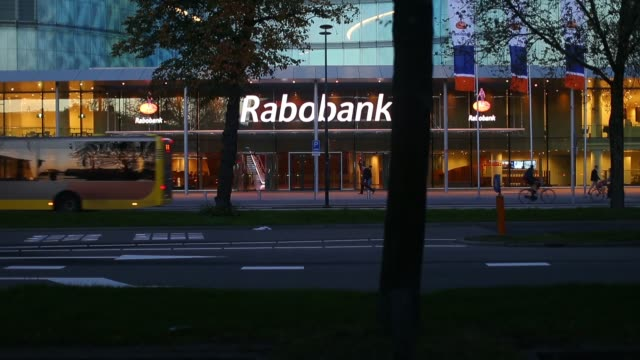 a customer on a bicycle stops to use an automated teller machine outside a branch of rabobank groep in utrehct netherlands on thursday oct 24 general... - utrecht stock videos and b-roll footage