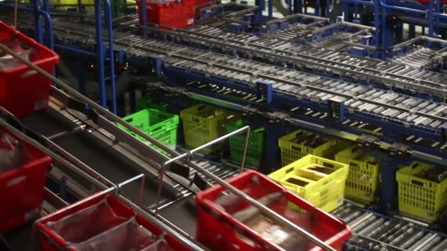 customer order crates travel along conveyor belts at the ocado group plc distribution centre in dordon, uk, on friday, dec 16, 2016 - plc stock videos & royalty-free footage