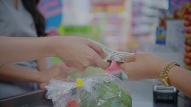 slo mo customer paying cash for goods with the cashier,close-up - banknote stock videos & royalty-free footage