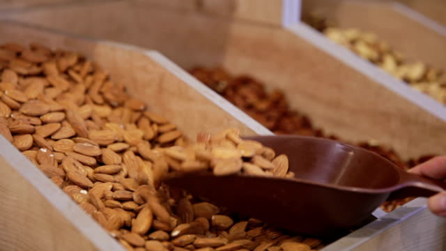 customer purchases almond in grocery - nut food stock videos & royalty-free footage
