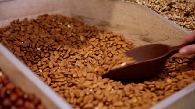 customer purchases almond in grocery - almond stock videos and b-roll footage