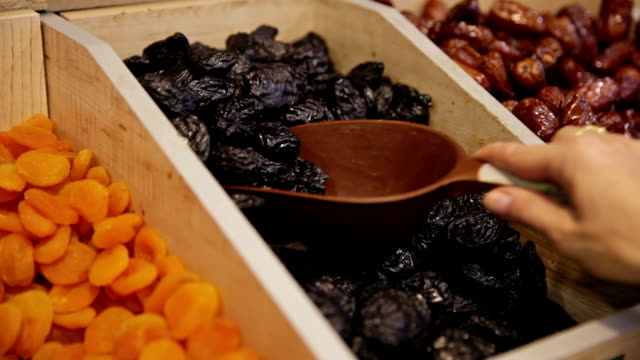 customer purchases drained prune in grocery - apricot stock videos & royalty-free footage