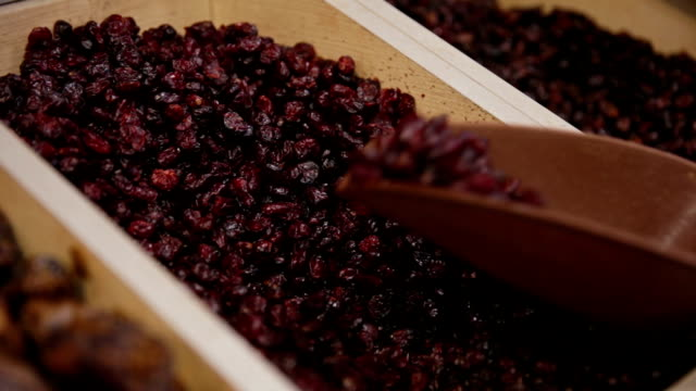 Customer purchases dried cherry in grocery