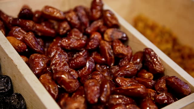 Customer purchases dried dates in grocery