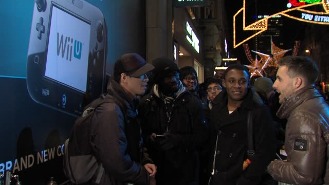 Customer queue outside the HMV store at UK Launch Of Nintendo WiiU Console at HMV Oxford Street on November 29 2012 in London England