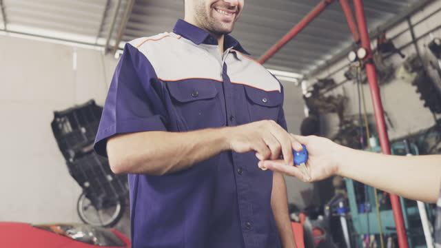 customer receiving a car keys from auto mechanic - part of vehicle stock videos & royalty-free footage
