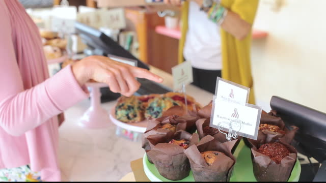 TU Customer selecting baked goods in bakery cafe / Los Angeles, California, United States